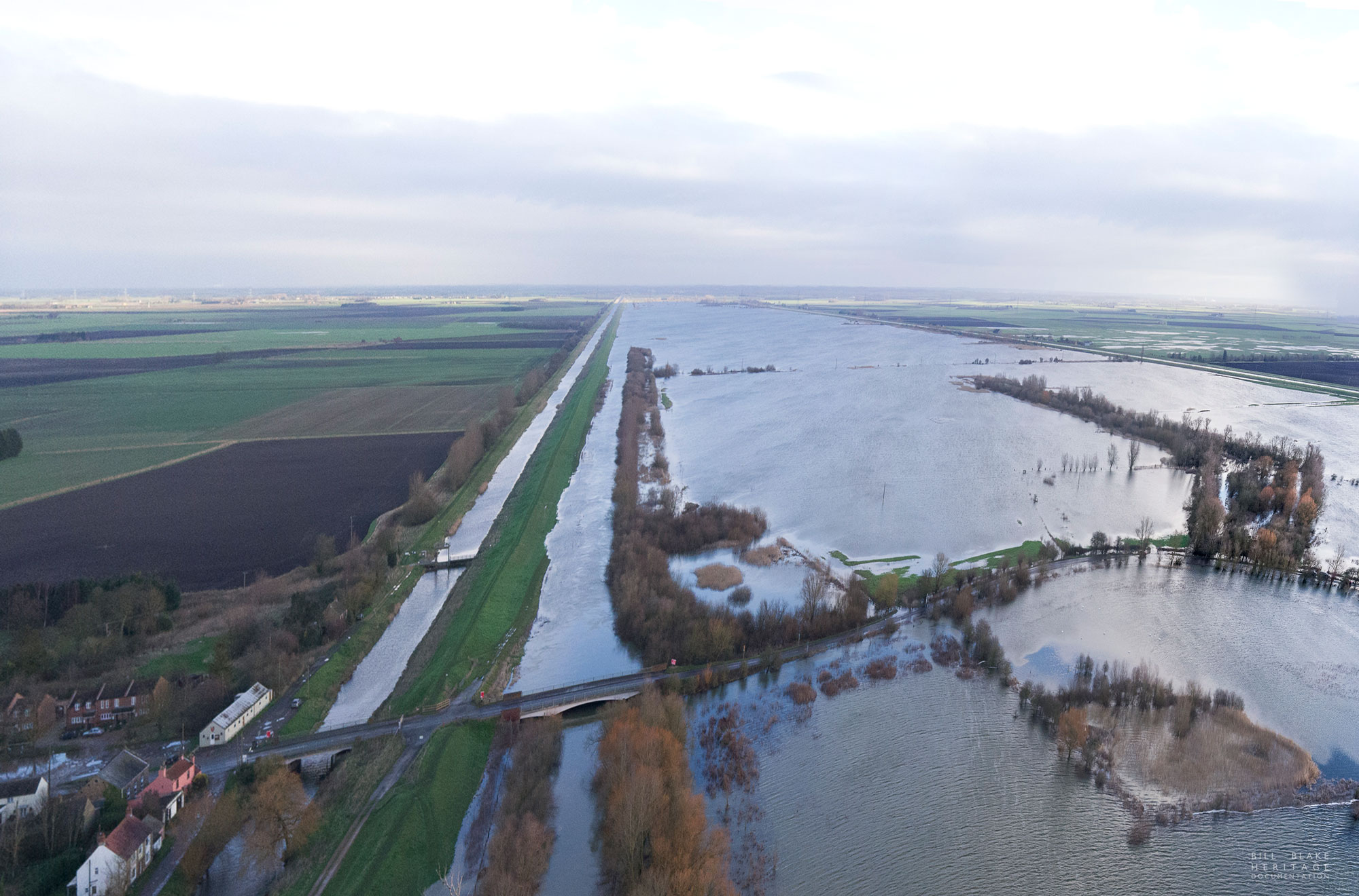 aerial view of the Ouse Washe and Welney Wash road flooded